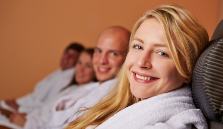 Blonde woman smiling relaxed in a spa in her holidays photo