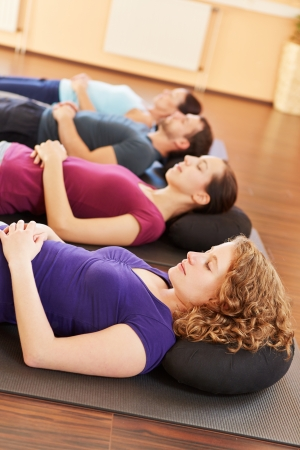 Group doing some relaxation exercises in a health club Stock Photo - 16630648