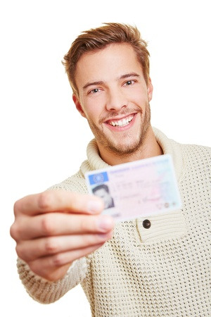 Happy smiling man with his European drivers licence photo