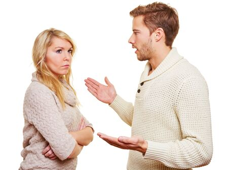 marital: Angry man argueing with sulking woman with the arms crossed