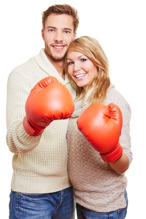 Attractive young couple with two red boxing gloves photo