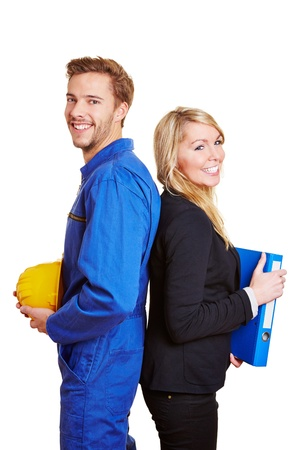 Worker in overall and business woman in a suit smiling together Stock Photo - 16931710