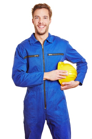 Happy smiling construction worker in blue jumpsuit with yellow hardhat