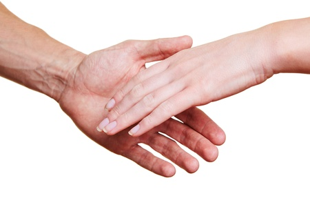reaching hand: Two people shaking the hands for a welcome greeting
