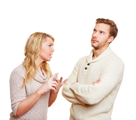 Couple argueing in over a problem with angry woman and sulking man photo