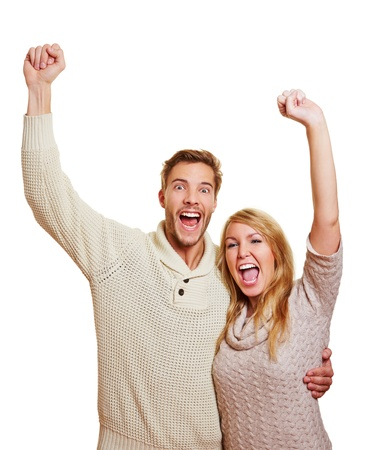 people laughing: Young attractive couple cheering together with their clenched fists