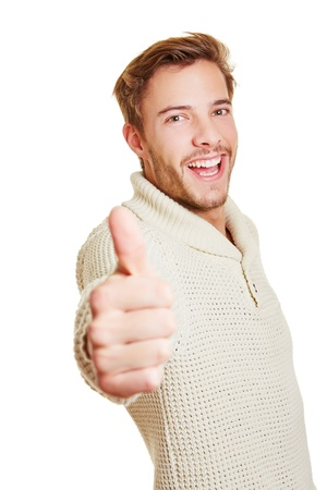 Happy attractive smiling man holding his thumbs up Stock Photo - 16982125