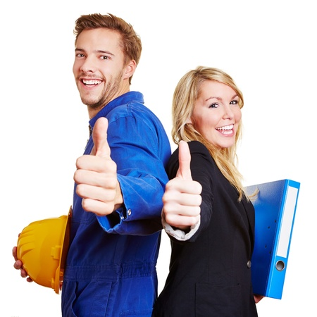two thumbs up: Happy construction worker in overall and business woman holding their thumbs up