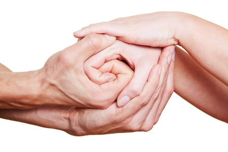 grasp: Many hands holding on to each other in a group