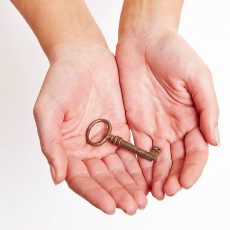 The key to success laying on the hand