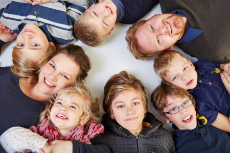 Family with many children in a circle looking up Stock Photo - 16979649