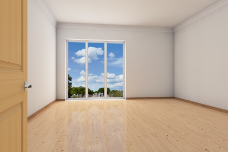 Empty room in an apartment with big windows photo
