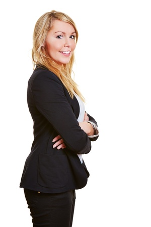 Smiling happy business woman in a suit with her arms crossed photo