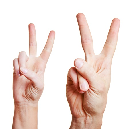 quantity: Two hands showing the victory sign with raised index and middle finger Stock Photo