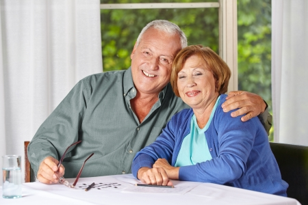 nursing allowance: Portrait of happy old senior couple in a retirement home Stock Photo