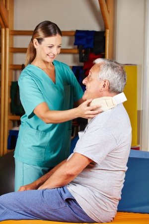 health club: Old man with ruff neck and nurse at a physiotherapy