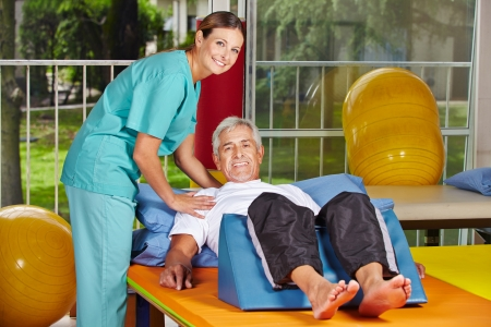 disabled sports: Senior man getting rehab at physiotherapy in nursing home Stock Photo