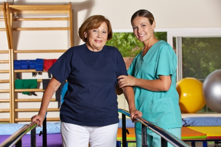 rehab: Senior woman doing kinesiotherapy in rehab with physiotherapist