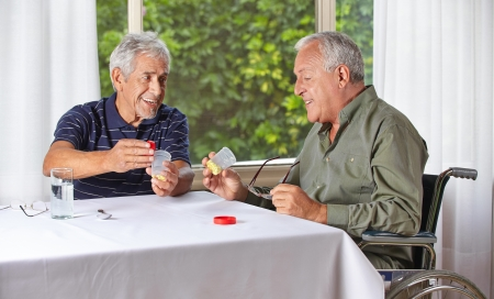 rehab: Two happy senior people taking medication in a nursing home