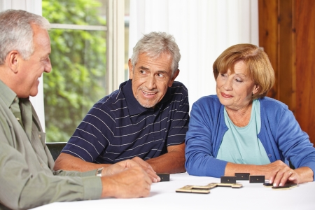 demented: Three senior people playing domino together in a retirement home Stock Photo