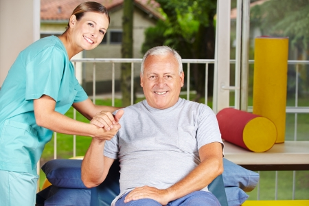 eldercare: Senior man getting physiotherapy with a physiotherapist Stock Photo