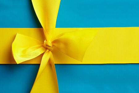 national colors: Blue gift with a yellow ribbon in the design of the national colors of Sweden