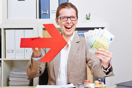 Happy business woman pointing with arrow to Euro money bills Stock Photo - 18064447