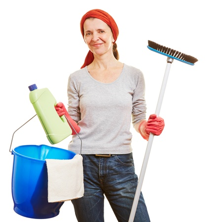 Happy senior woman making spring cleaning with cleaning products photo