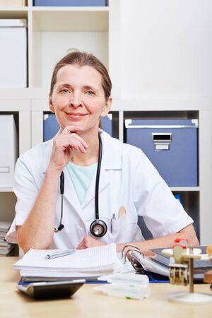 Portrait of happy senior female doctor in her office Stock Photo - 18127609