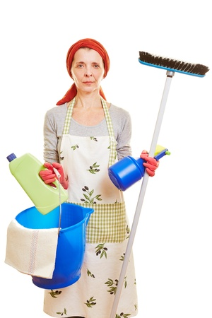Cleaning lady with cleaning supplies and apron photo