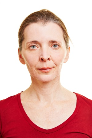 neutral face: Neutral frontal female senior face looking into the camera Stock Photo
