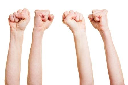 puÑos: Muchos puños airados metiendo la mano en el aire Foto de archivo