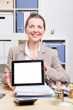 Business woman making presentation with tablet computer in her office photo