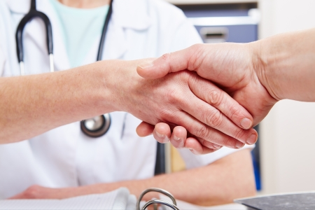 farewell: Handshake between doctor and a patient in the office Stock Photo