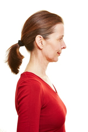 ponytail: Senior woman in profile view with ponytail Stock Photo