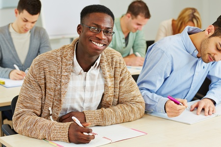 Happy smiling african student taking notes in university class Stock Photo - 18326822
