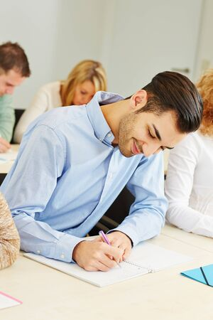 Student studying in course in university and taking notes Stock Photo - 18324024