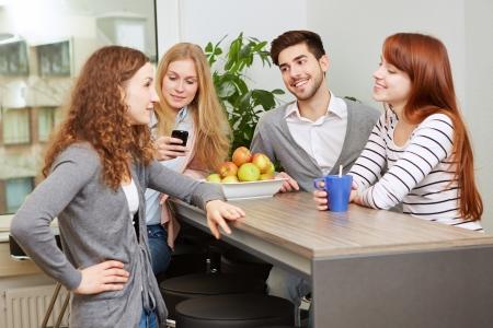 work break: Creative business team taking a break in social room