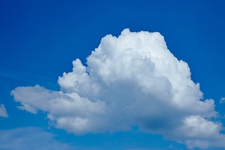 Single big white cloud in a blue sky photo