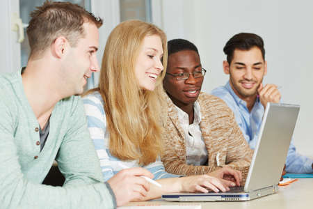 computer lessons: Happy students taking private lessons online with laptop computer