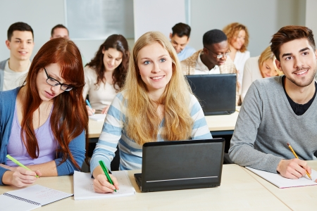 academy: Students studying with laptop computer in class in university