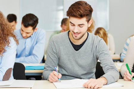 mann: Young mann taking a screening test in assessment center Stock Photo