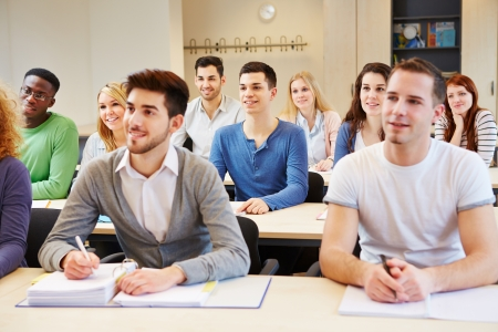 classroom: Many students in seminar studying and listening in university classroom Stock Photo