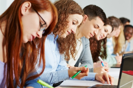 college classroom: Many students learning together in a school class