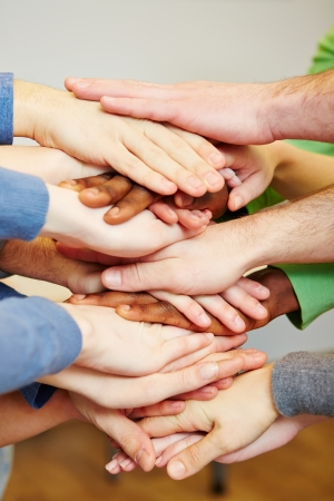 Team stacking many hands on top of each other for motivation Stock Photo - 18594557