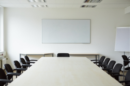 meeting room: Clean bright white conference room with a whiteboard Stock Photo