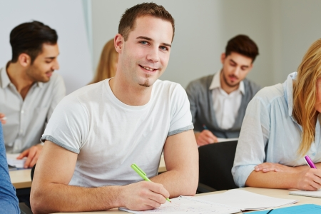 Happy student studying in a course of a college photo