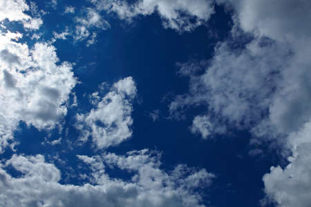 infinitely: Blue sky with many different white clouds Stock Photo