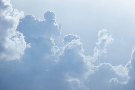 infinitely: Many clouds forming in a bright sky Stock Photo