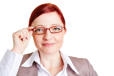 Attractive best ager business woman with red glasses Stock Photo - 18919831